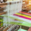 Weaving loom and shuttle on the warp — Stock Photo #69412337