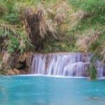 Waterfall in rain forest (Tat Kuang Si Waterfalls at Luang praba — Stock Photo #76835411