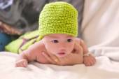 Portrait of cute newborn baby girl on the bed — Stock Photo