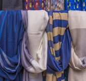 Colorful of scarves in a textiles market — Stock Photo