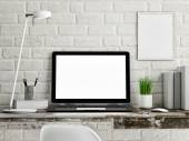 Laptop on wooden table, white brick wall — Stock Photo