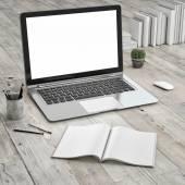 Laptop on wooden floor — Stock Photo