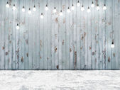 Blue wooden wall with ligh bulbs, background — Stock Photo