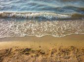 Affectionate sea wave on a sandy beach — Stock Photo
