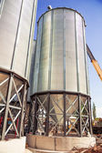 Background, metal barrels granaries on the sky background — Stock Photo