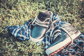 Men's shoes on the grass wrapped in a scarf — Stock Photo