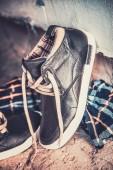 Men's sneakers in the dust on the asphalt — Stock Photo