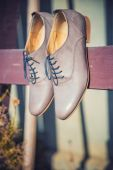 Women's shoes hanging from a wooden board — Stock Photo