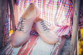 Women's shoes are painted on old blackboard — Stock Photo