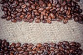 Background of coffee on sackcloth — Stock Photo