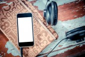Phone and headphones over wooden background music — Stock Photo