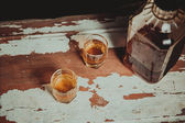 Two glasses of whiskey standing on the bar — Стоковое фото