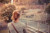 Young woman standing by animal enclosure — Stock Photo