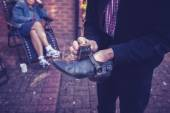 Senior man polishing shoes — Stock Photo
