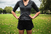 Woman in shorts standing in the park — Stock Photo