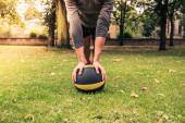 Young woman exercising with medicine ball in park — Stock Photo