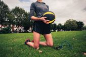 Woman with medicine ball and resistance band — Stock Photo
