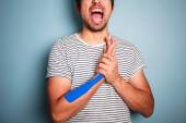 Young man with kinesio tape on his arm — Stock Photo