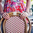Woman standing behind a chair outside — Stock Photo #54023069