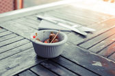 Small bowl of olives outside — Stock Photo