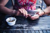 Woman using her smart phone outside — Stock Photo