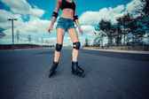 Young woman rollerblading — Stock Photo