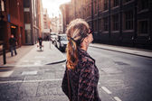 Young woman walking in the street — Stock Photo