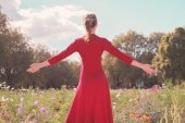 Young happy woman in a meadow — Stock Photo