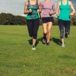 Three women running in the park — Stock Photo #57066181