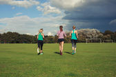 Three women running in the park — Stock Photo