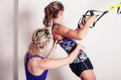 Athletic woman and personal trainer — Stock Photo