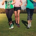 Three women running in the park — Stock Photo #57074373