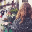 Woman outside a florist — Stok fotoğraf #57105839