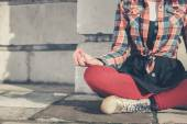 Young woman meditating in the street — Stock Photo