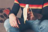 Young man with a banana — Stock Photo