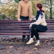 Young man and woman talking in park — Stock Photo #58556303