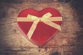 Heart shaped box on wood — Zdjęcie stockowe
