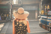 Young woman walking in the street of Asian country — Stock Photo