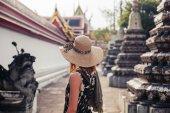 Woman exploring buddhist temple — Stock Photo