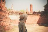 Woman exploring ancient ruins — Stock Photo