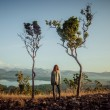 Woman standing between two trees — Stock Photo #69816413