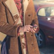 Woman using smart phone next to her car — Stock Photo #69892789