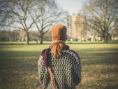 Woman walking in park on a winter day — Stock Photo