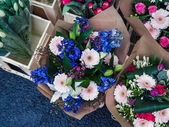 Bouquets of flowers at a market — Stock Photo