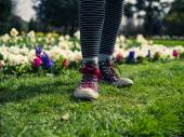 Young person standing on grass — Stock Photo