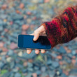 Young woman using smartphone outside — Stock Photo #74391031