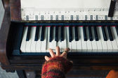 Hands of woman playing piano — Stock Photo