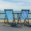 Two deck chairs by the seaside — Stock Photo #74403459