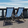Two deck chairs by the seaside — Stock Photo #74403735