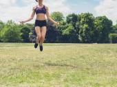 Woman skipping in the park — Stock Photo
